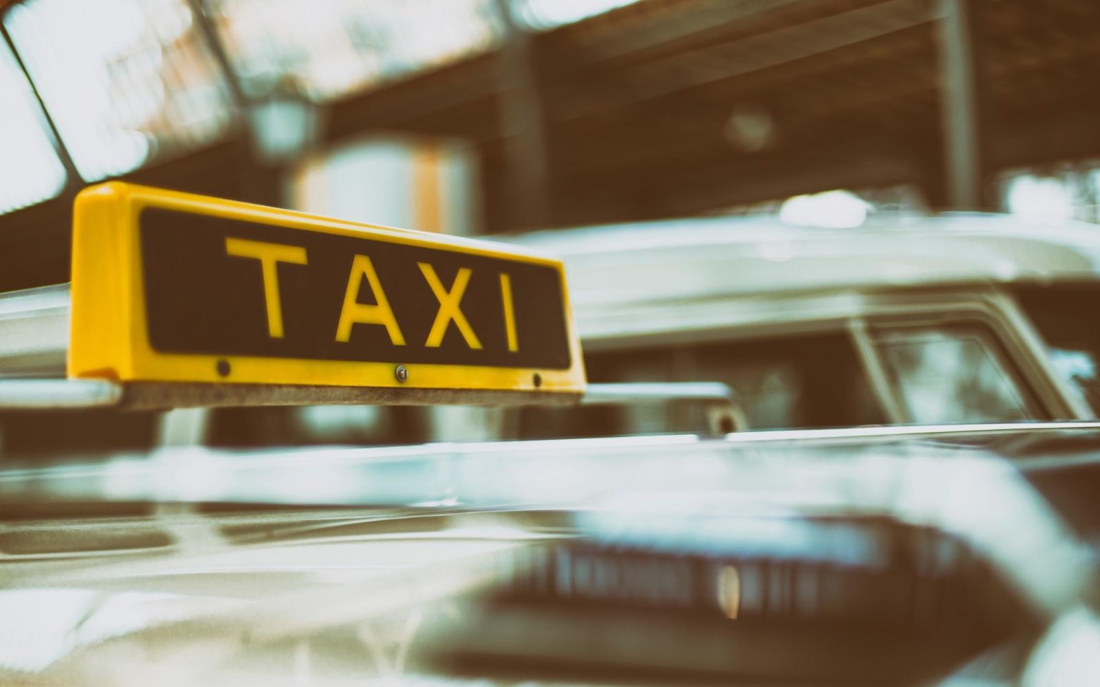 A taxi awaits a customer