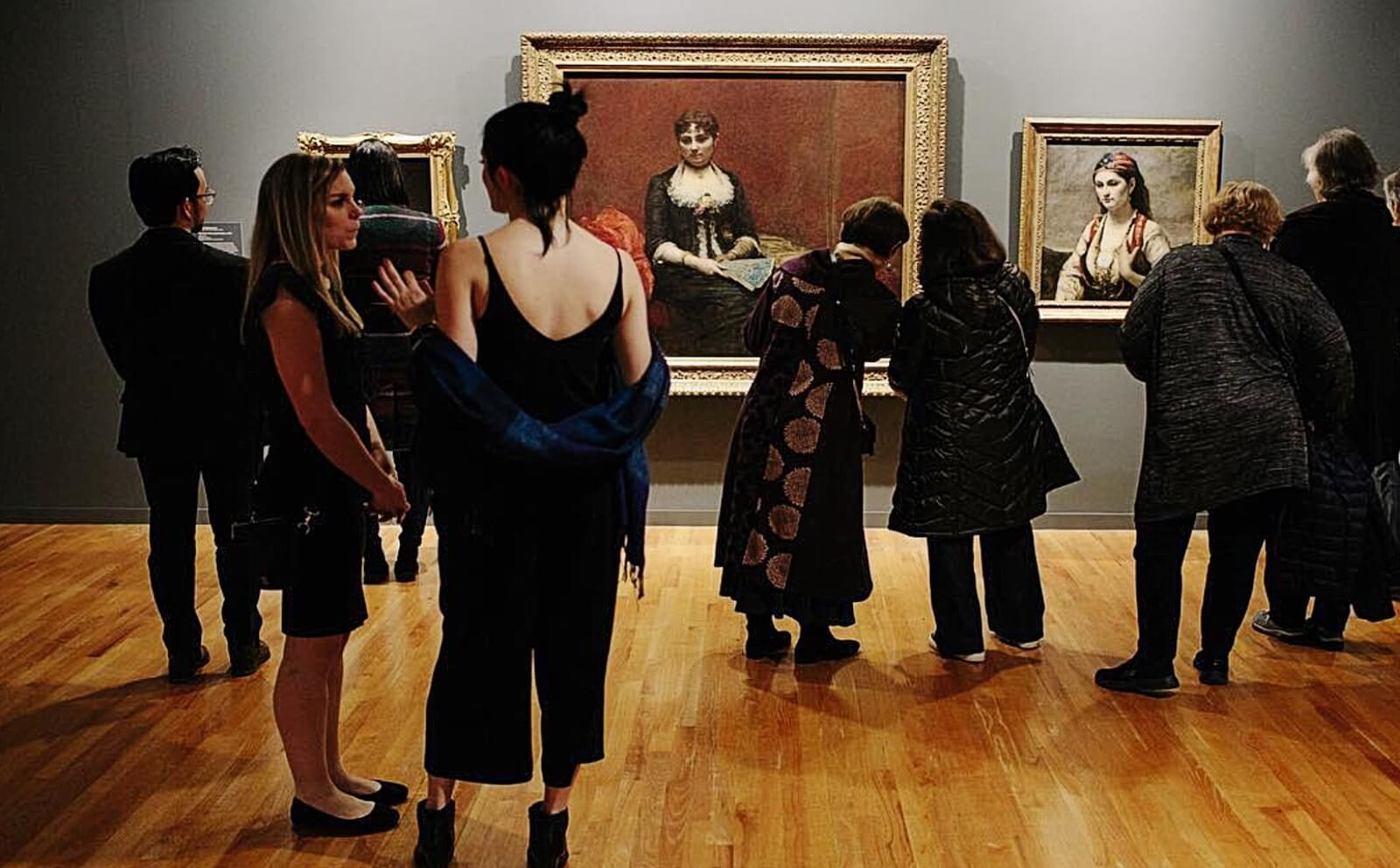 A group of women admire paintings at the Vancouver Art Gallery