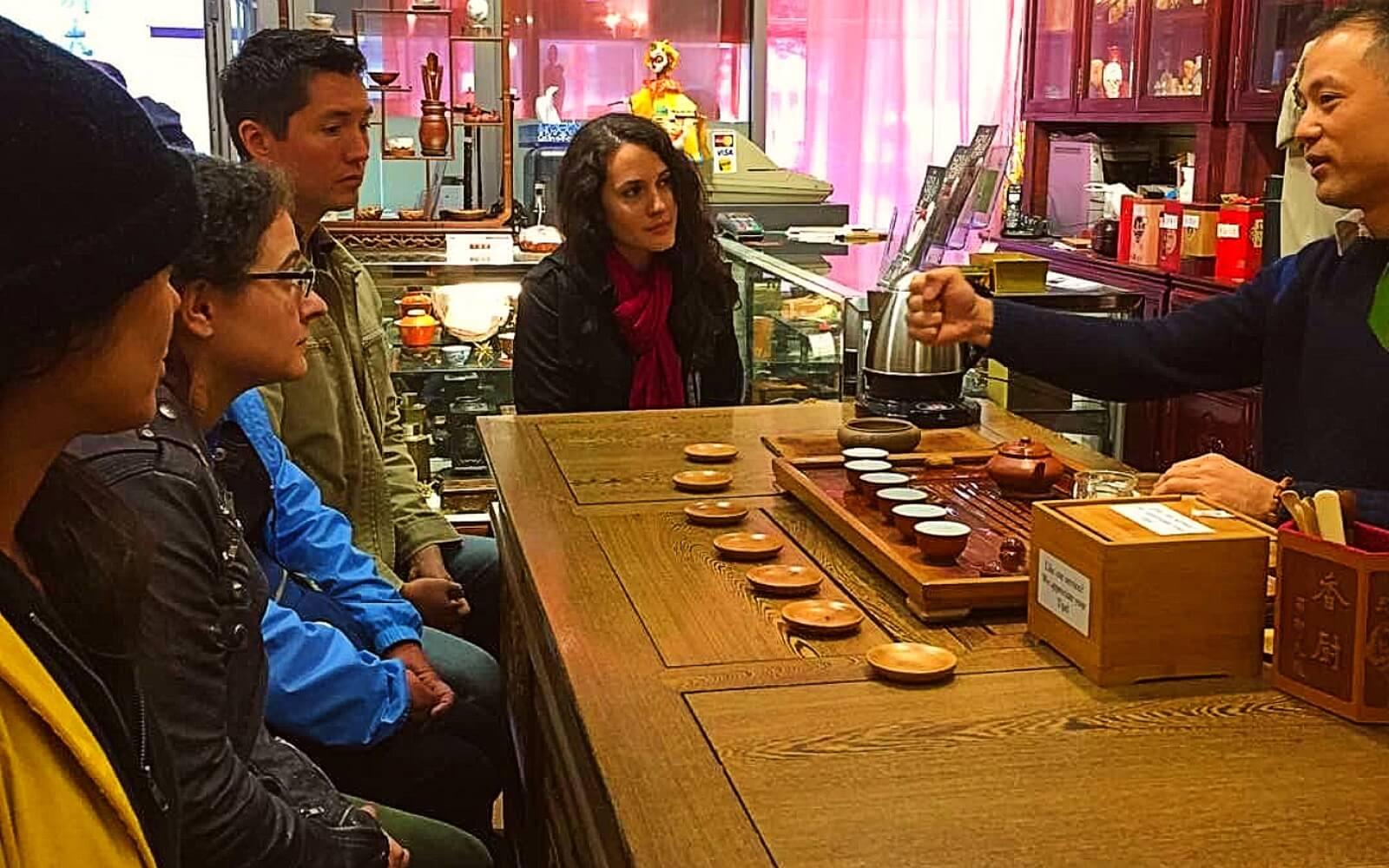 A group samples tea on the Wok Around Chinatown tour
