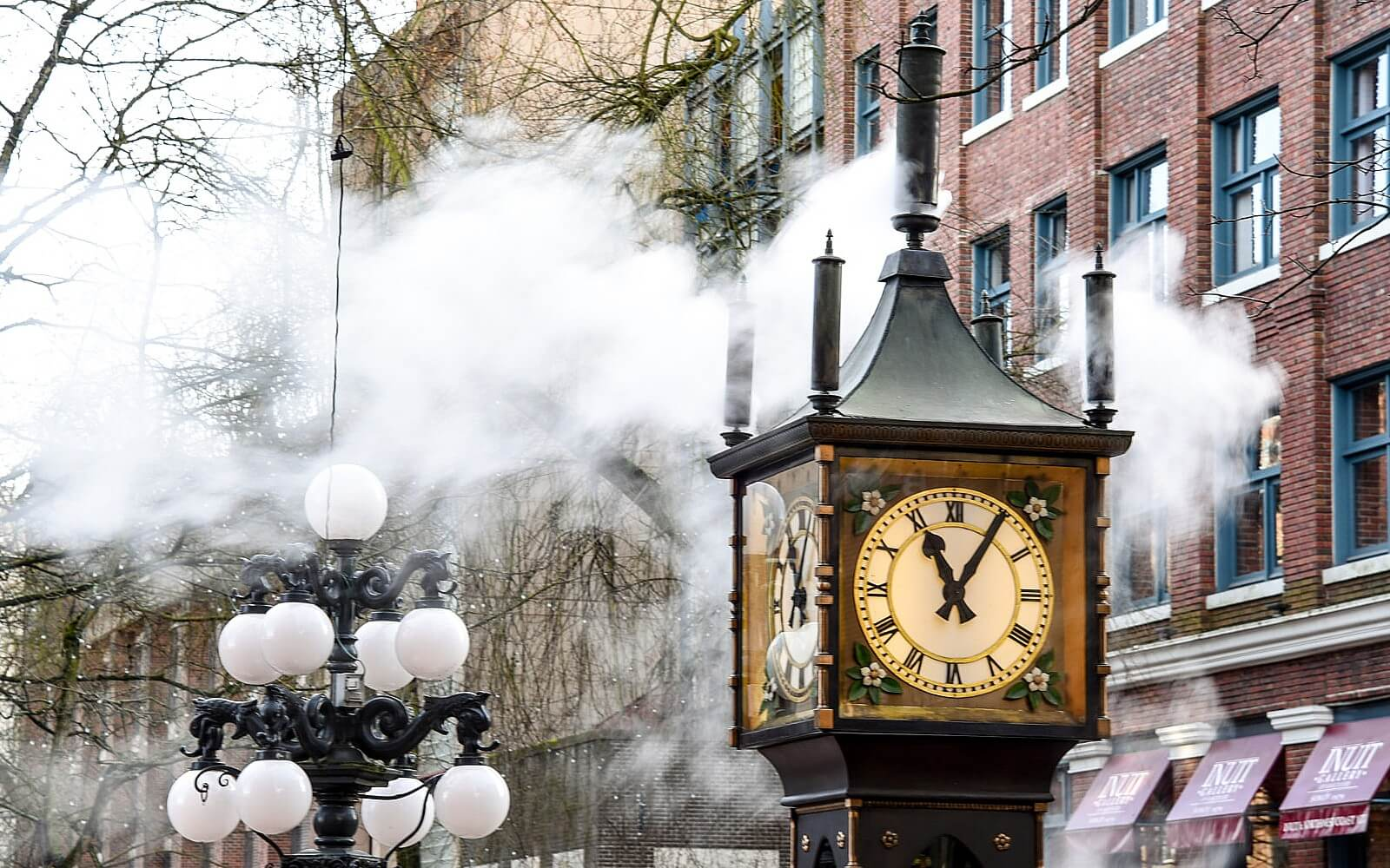 the gastown steam clock erupts with steam in vancouver canada
