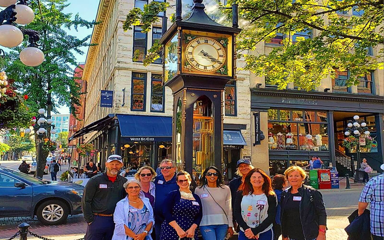 Guests on the Gastown Food Tour stand in front of the Gastown Steamclock