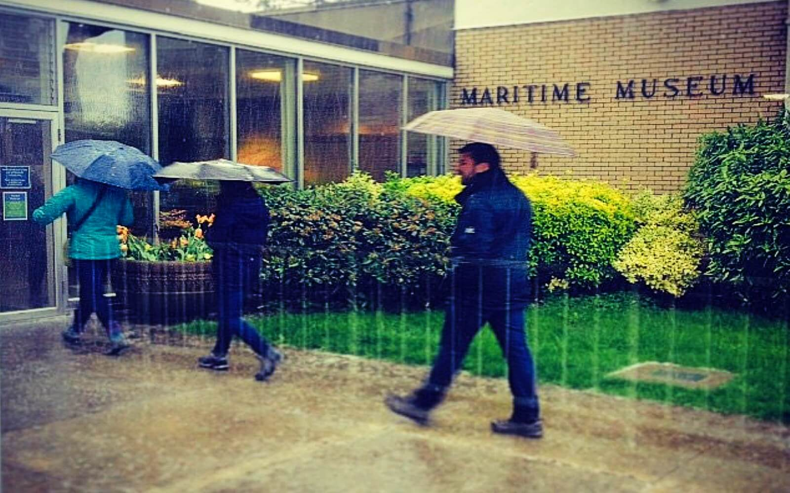 Customers brave the rain to enter the Vancouver Maritime Museum