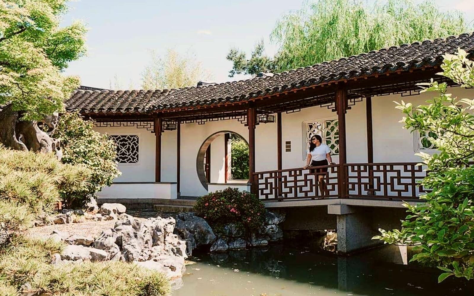 Woman overlooks a pond at the Sun Yat-Sen Classical Garden