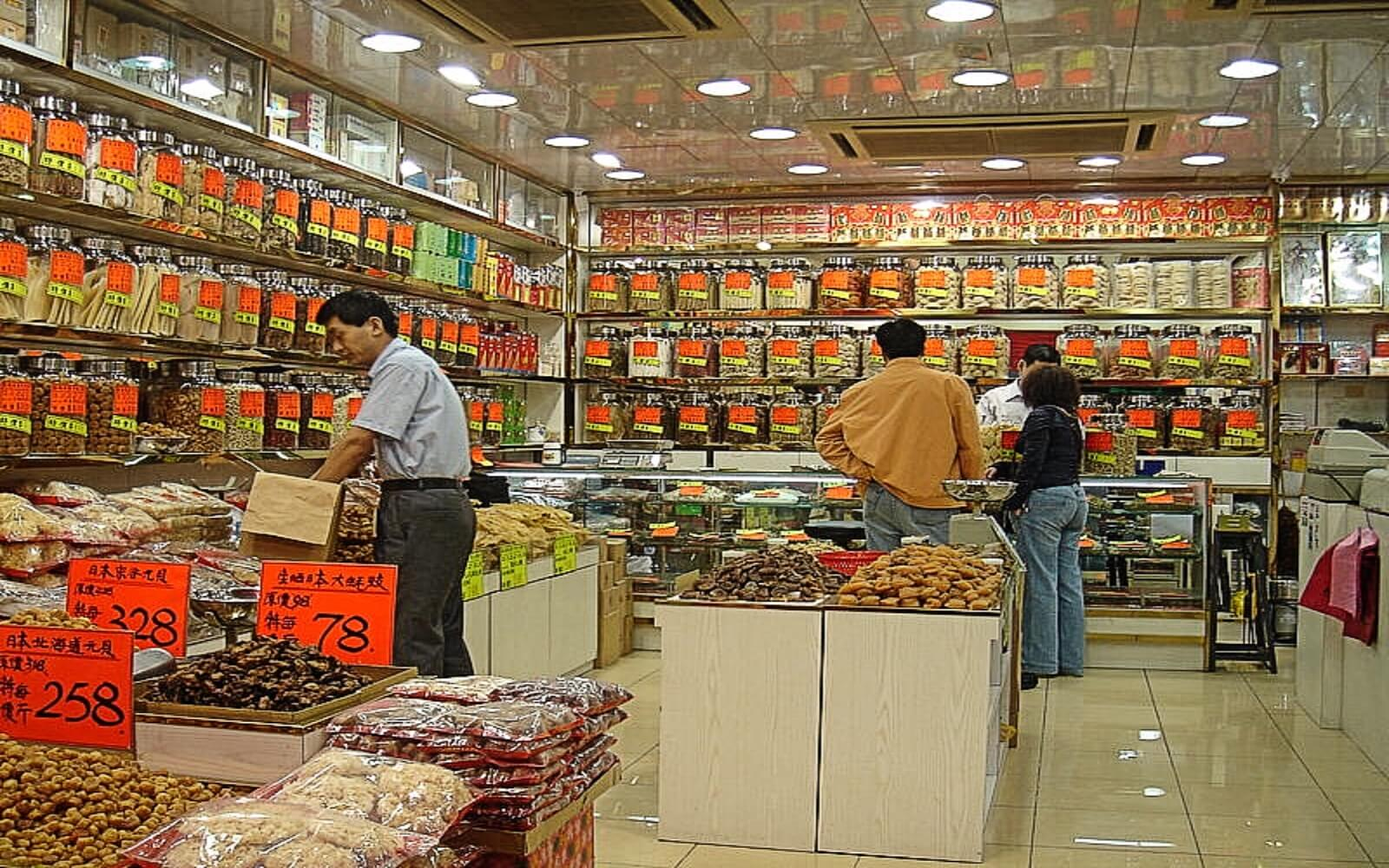 Customers shop at a Chinese Apothecary