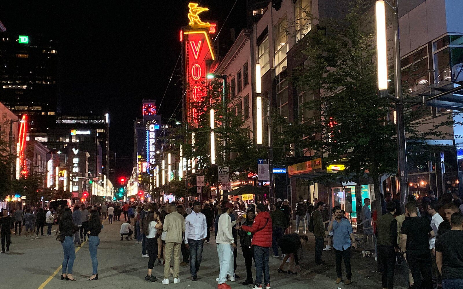 a crowd forms outside the bars on granville street in vancouver bc