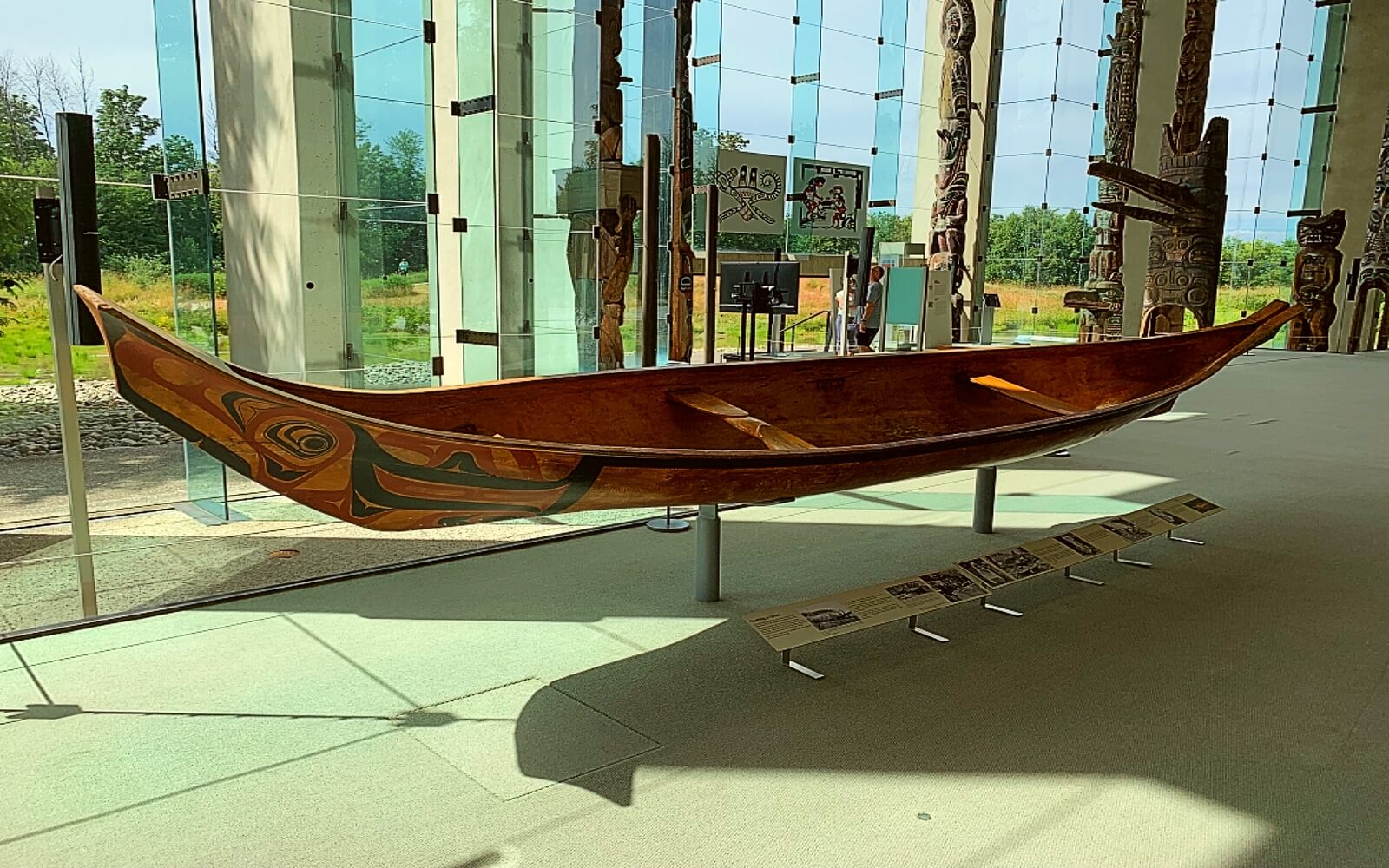 A canoe sits in the great Hall at the Museum of Anthropology