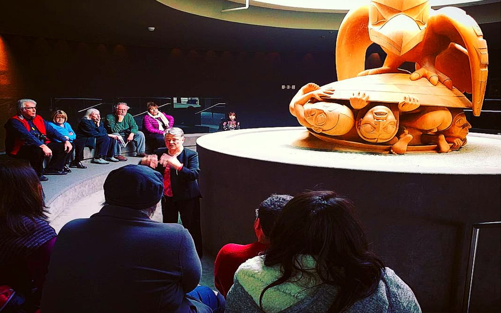 A free guided tour in the Bill Reid Rotunda at the MOA