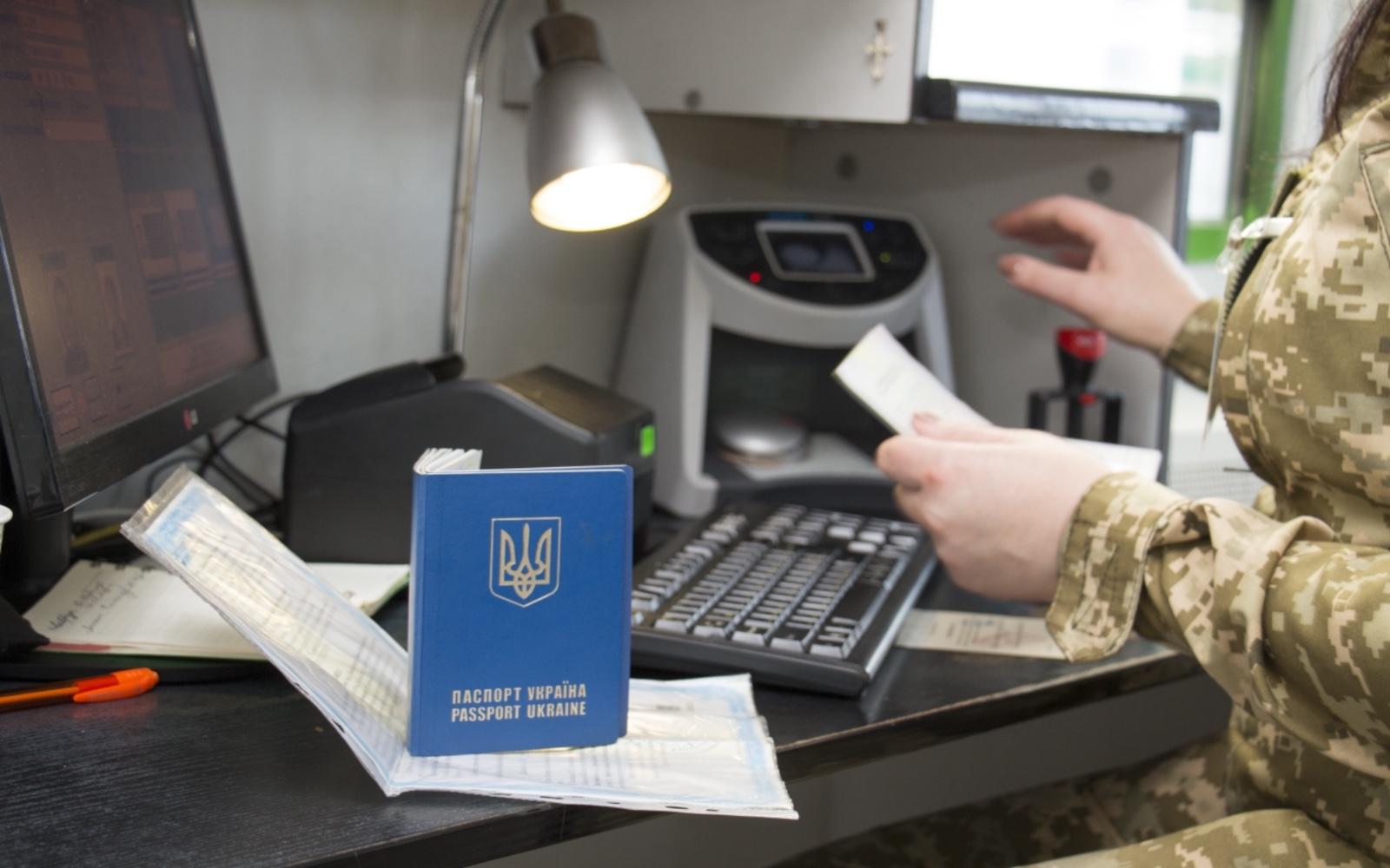 A border agent scans a passport