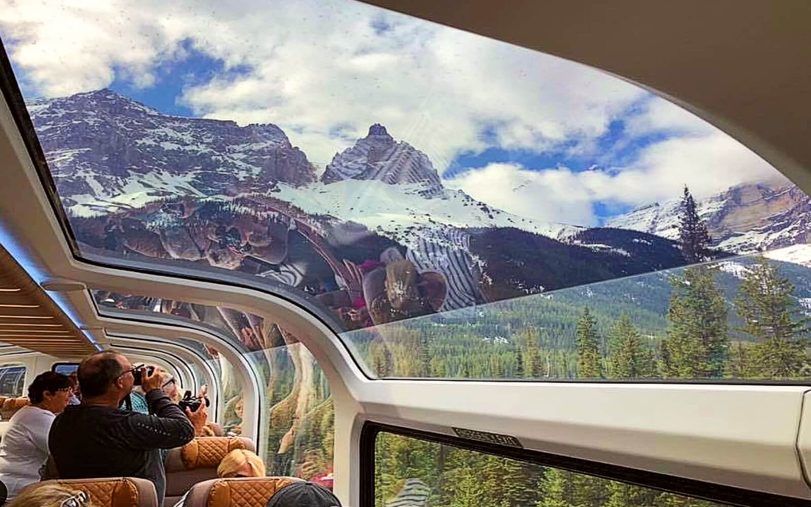 Passengers take pictures aboard the Rocky Mountaineer