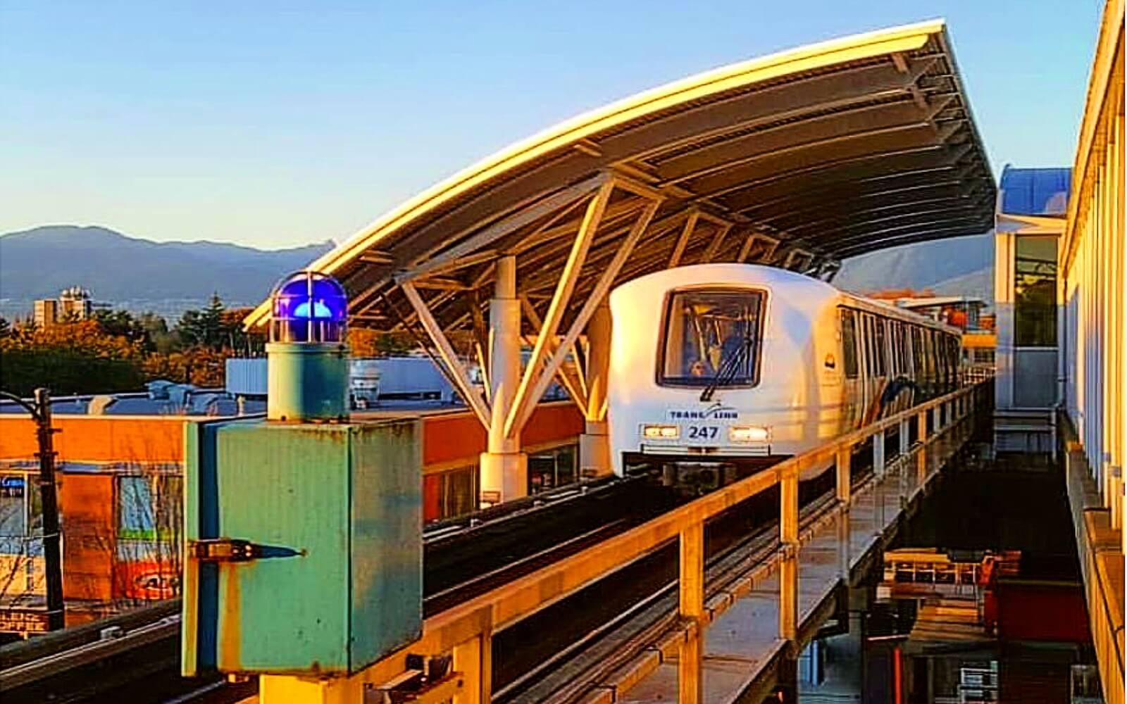 skytrain arrives at a station in vancouver canada