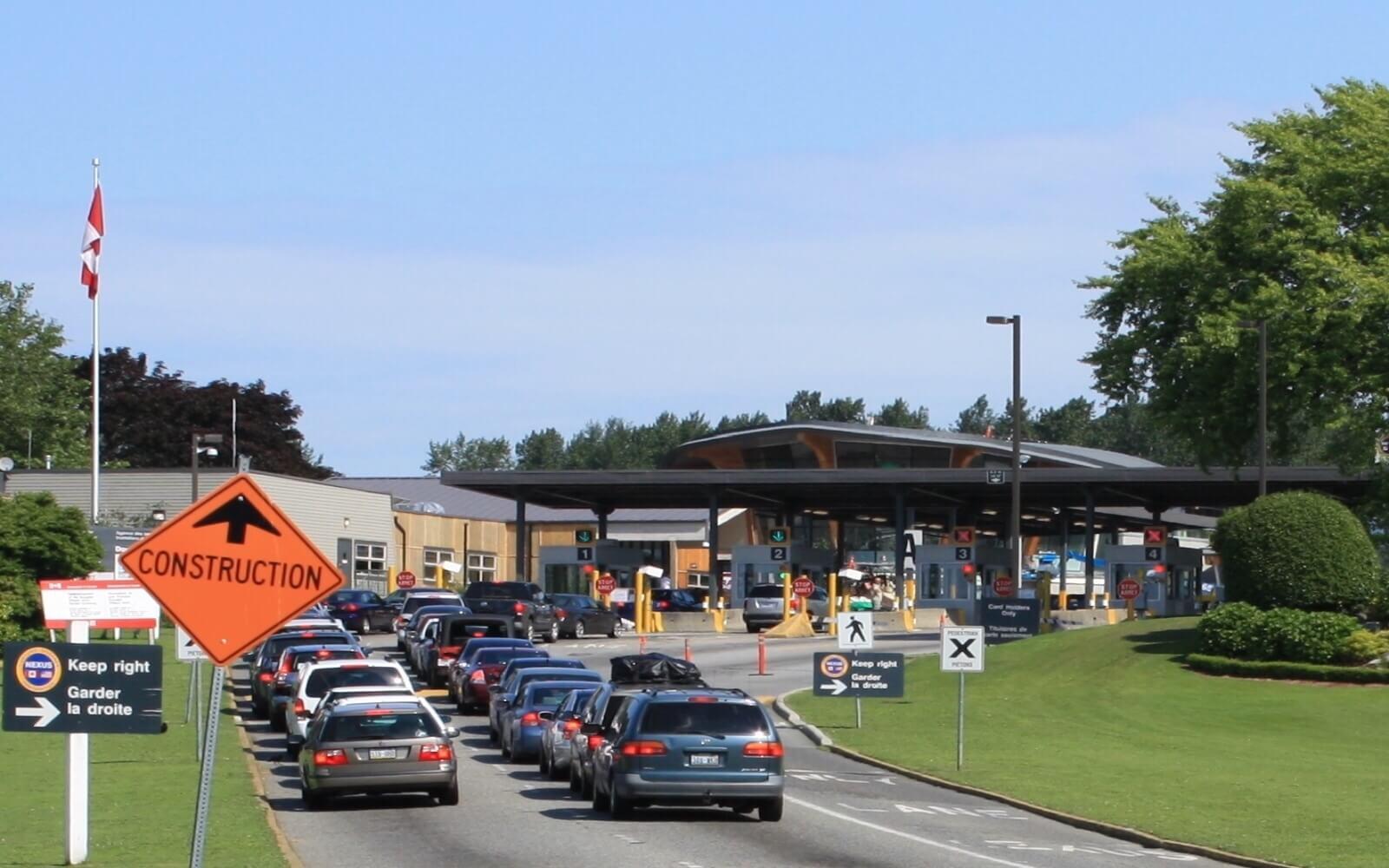 Cars wait at the US-Canada border