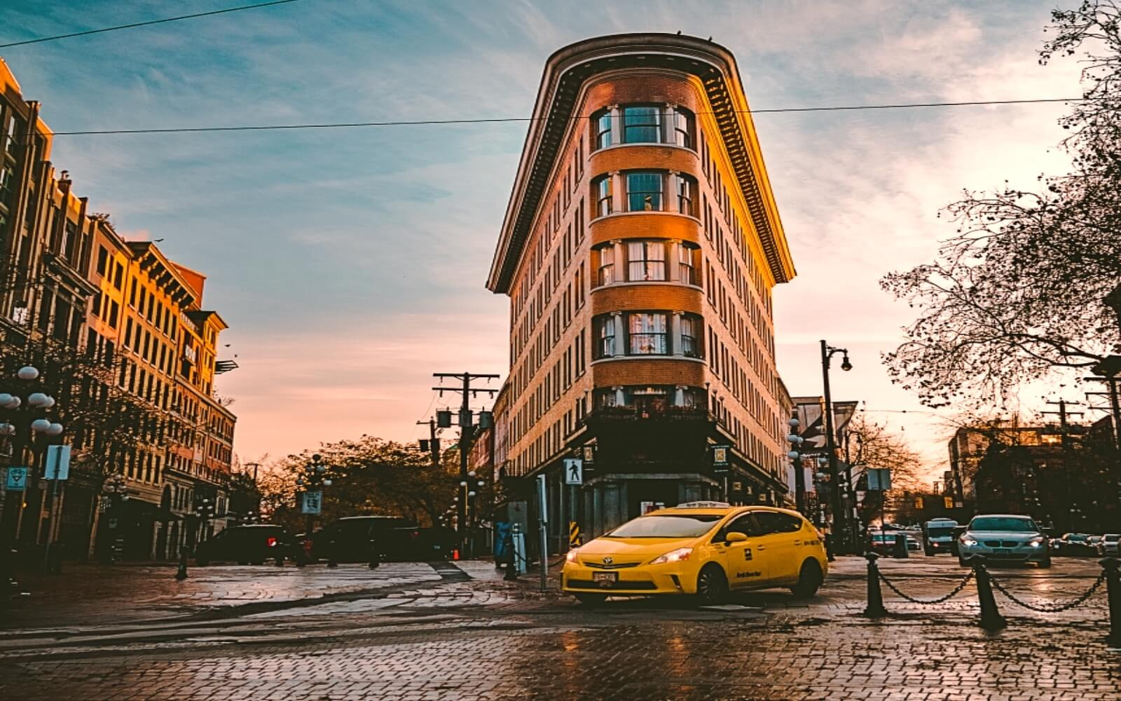 A taxi drives through Vancouver's Gastown