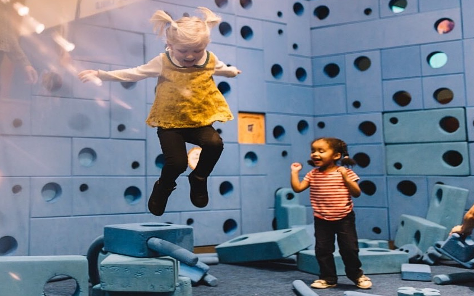 kids jump around in the wonder gallery vancouver bc