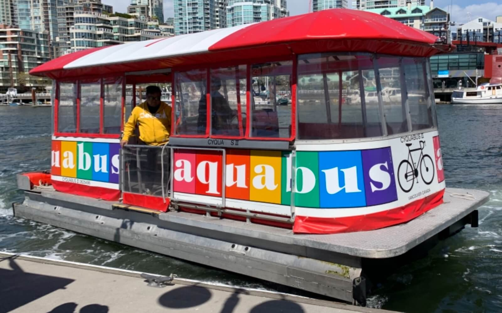 aquabus docking at granville island in vancouver bc canada