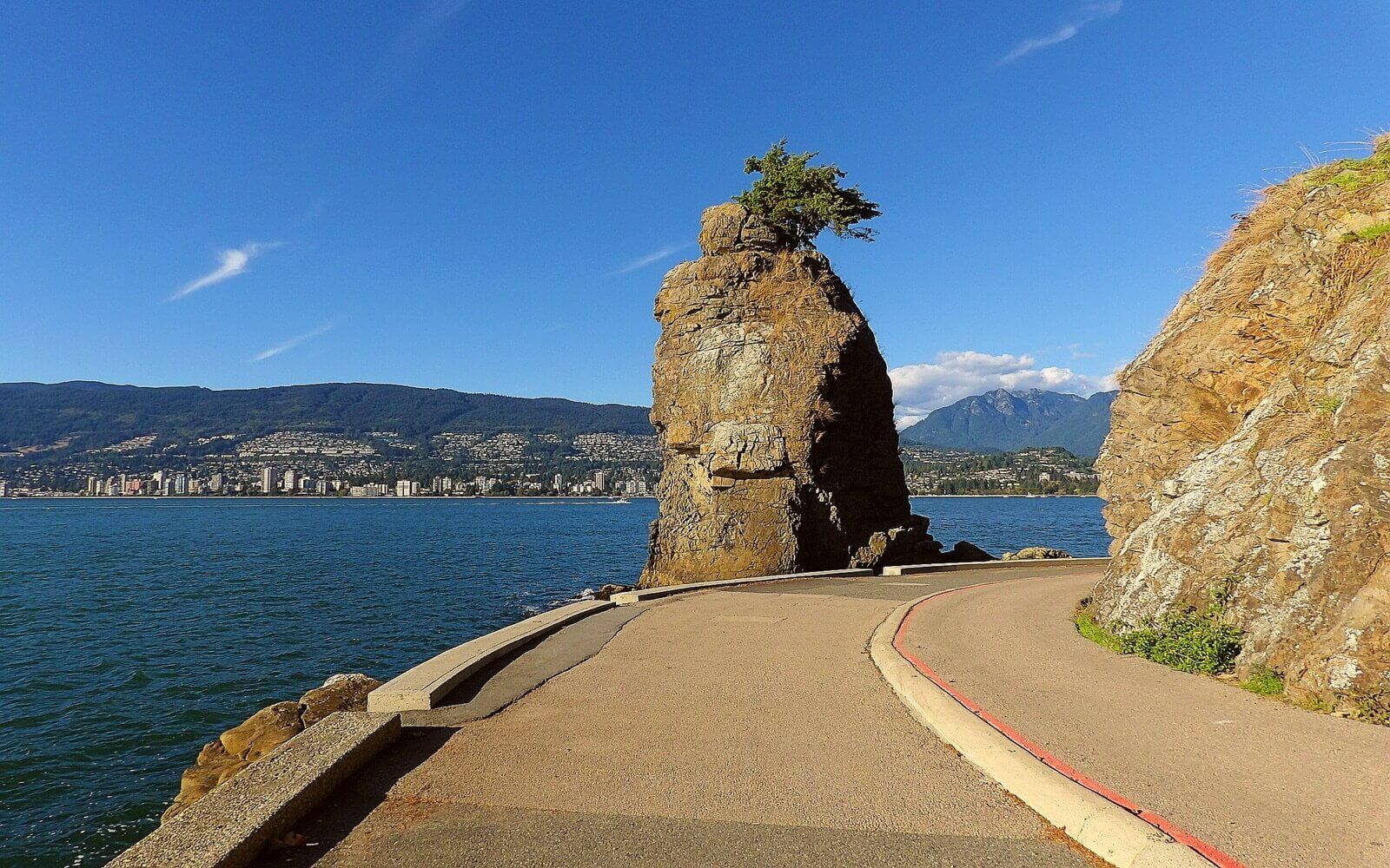 The seawall passes Siwash Rock
