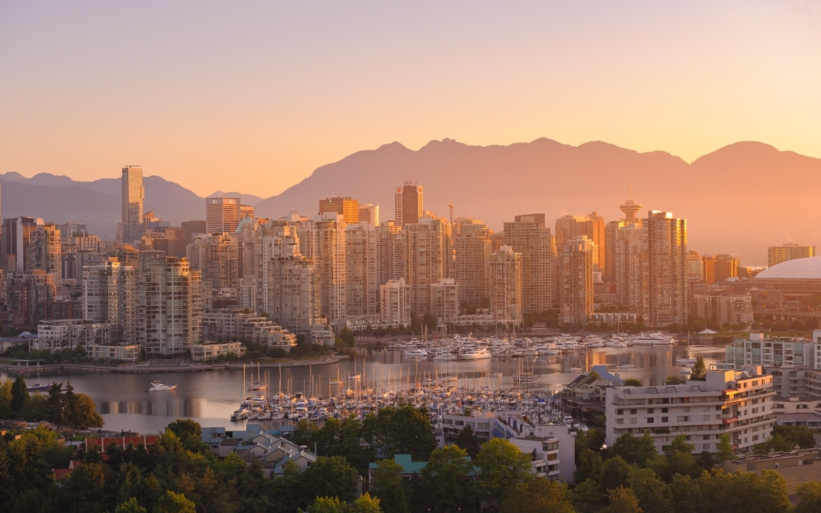 The sun rises over Vancouver's skyline