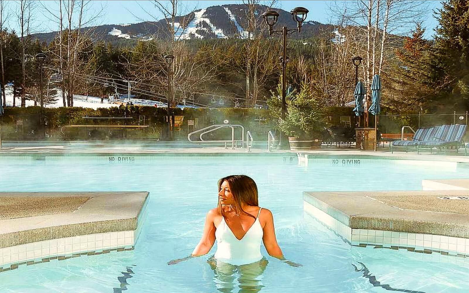 A woman enjoys the pool on a winters day in Whistler
