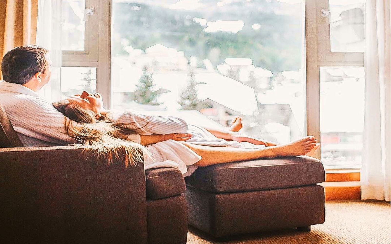 A couple relaxes at the Pan Pacific Mountainside Whistler