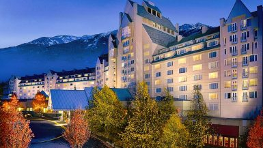 The Fairmont Chateau Whistler in front of Whistler Mountain