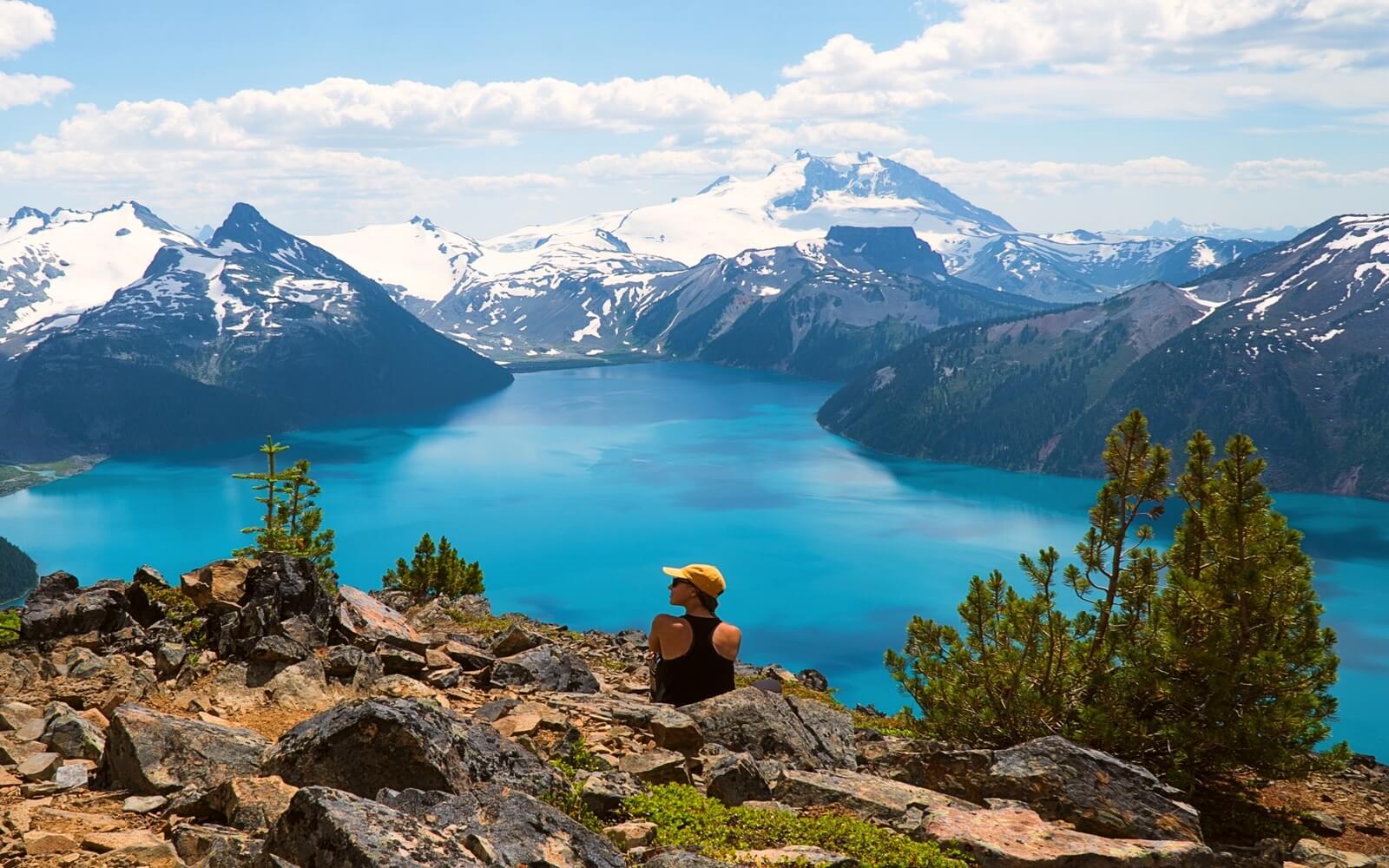 A woman admires the view of Garibaldi Lake