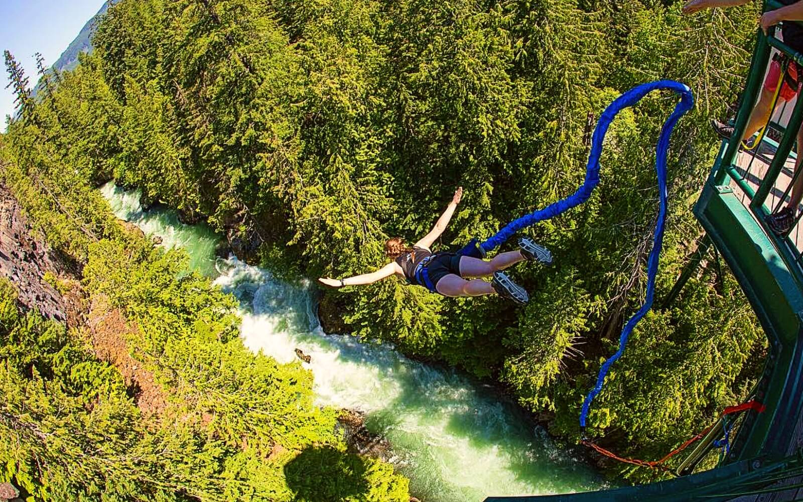 A customer dives off the bridge at Whistler Bungee