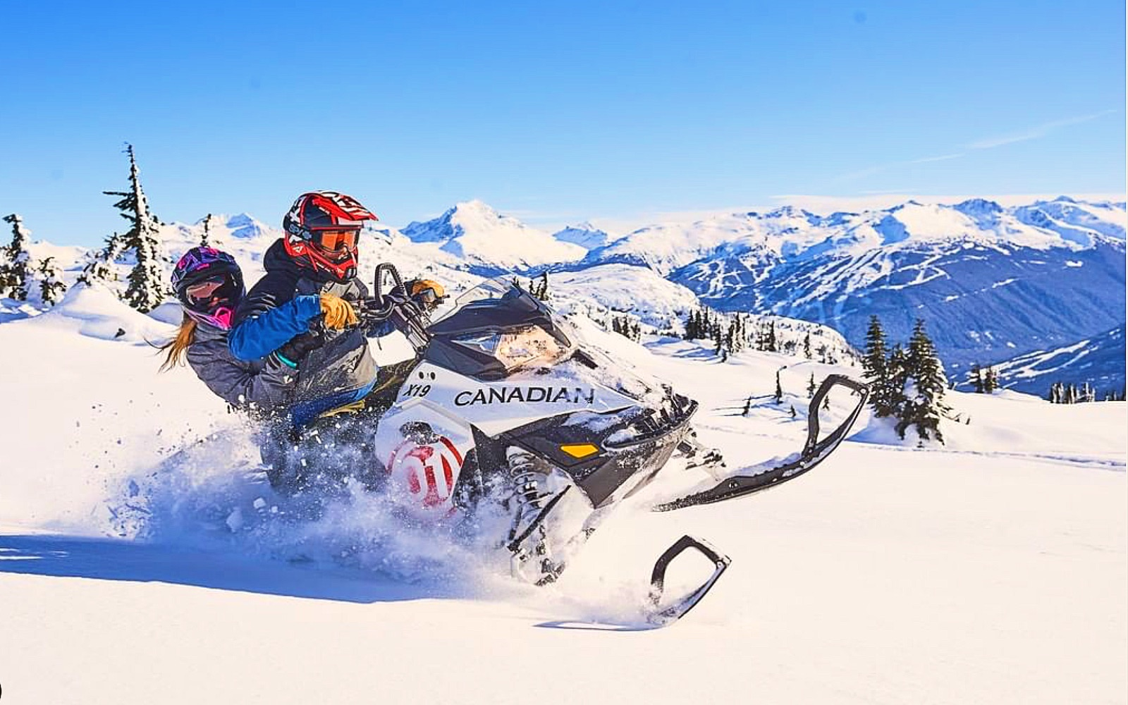 A pair of snowmobilers plow through the Coast Mountains