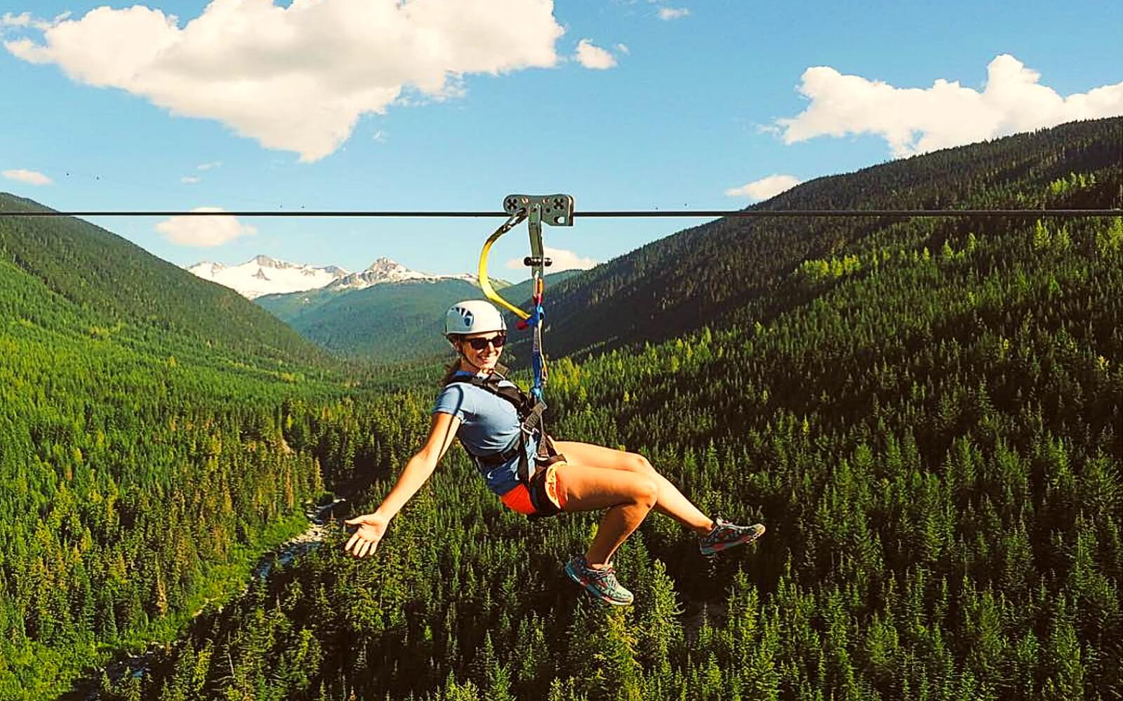 A woman ziplines in Whistler, BC