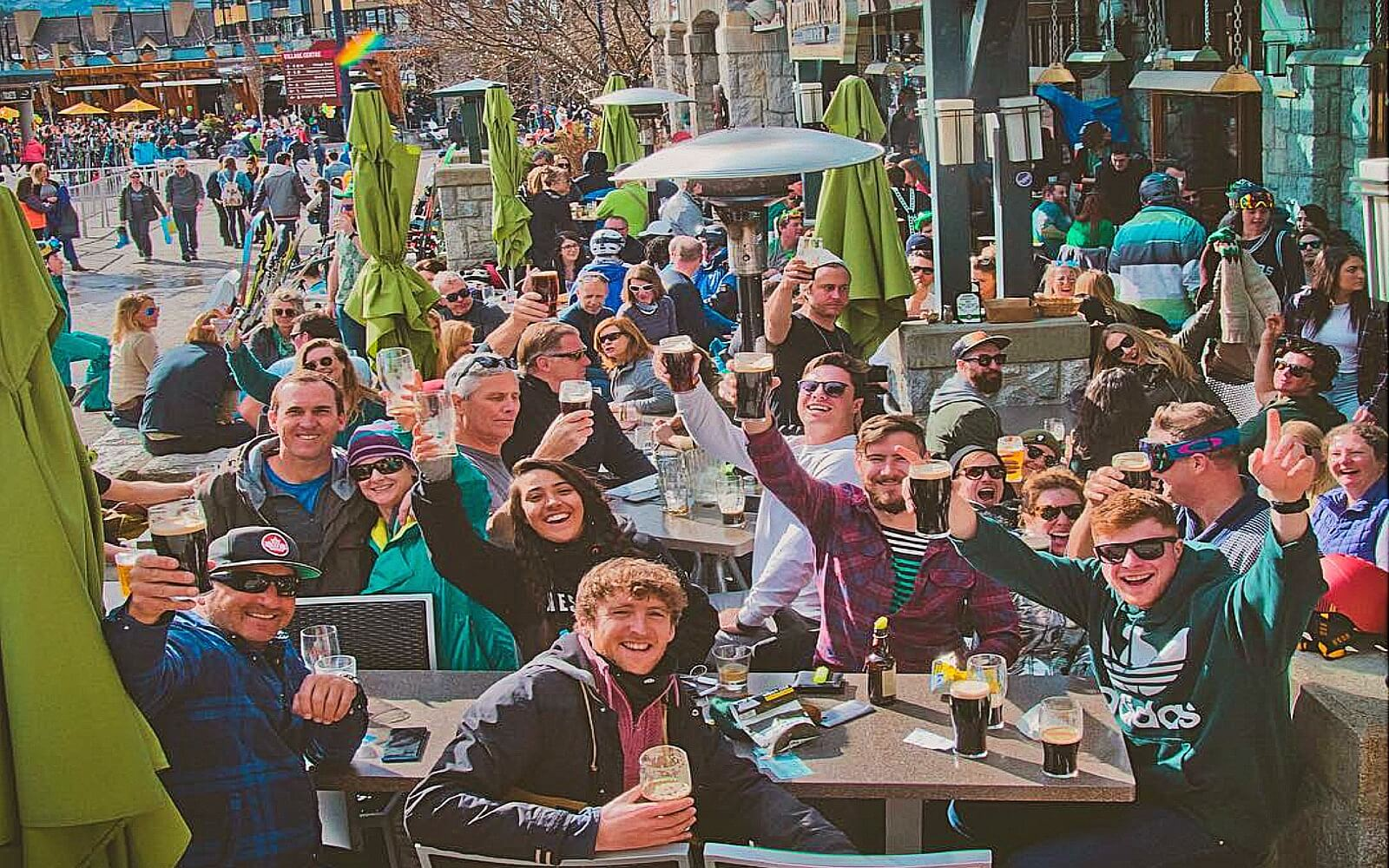 A crowd drinks on the patio at Dubh Linn Gate, Whistler