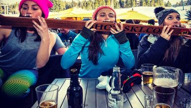 Three girls take shots off the shot-ski at the Longhorn Saloon