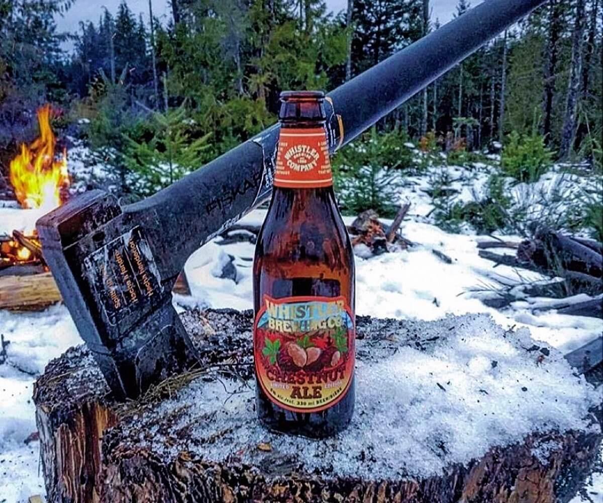 a bottle Whistler Brewing of beer in the wilderness