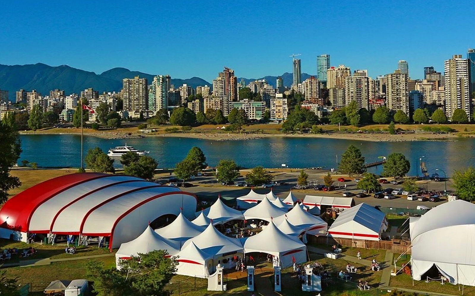 An aerial shot of the Bard on the Beach Festival in front of the Vancouver skyline