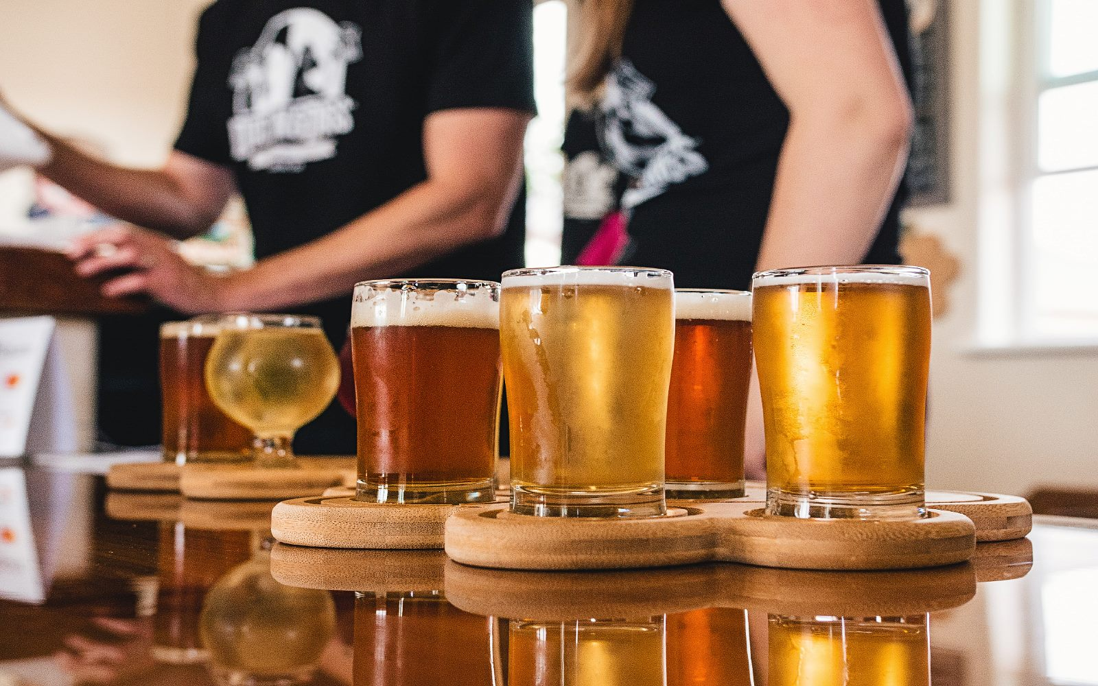 Beer tasters sit on a table at a Craft Brewery