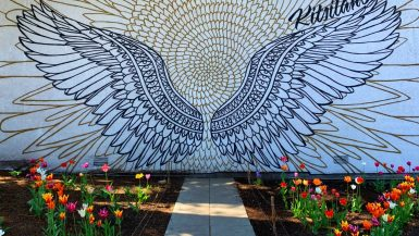 a painted wing mural with flowering tulips in the kitsilano area in vancouver