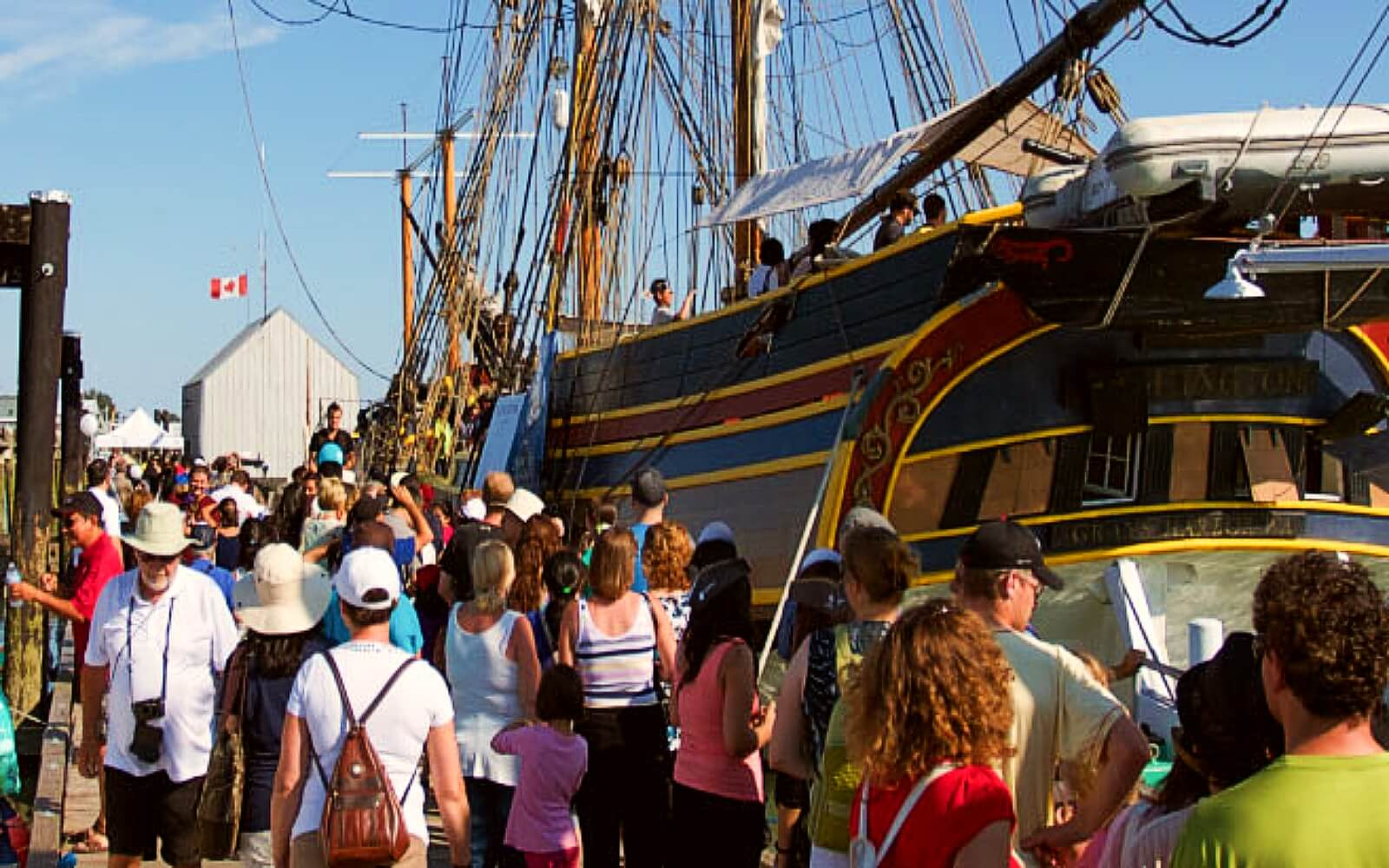 A crowd boards a tallship at the Richmond Maritime Festival