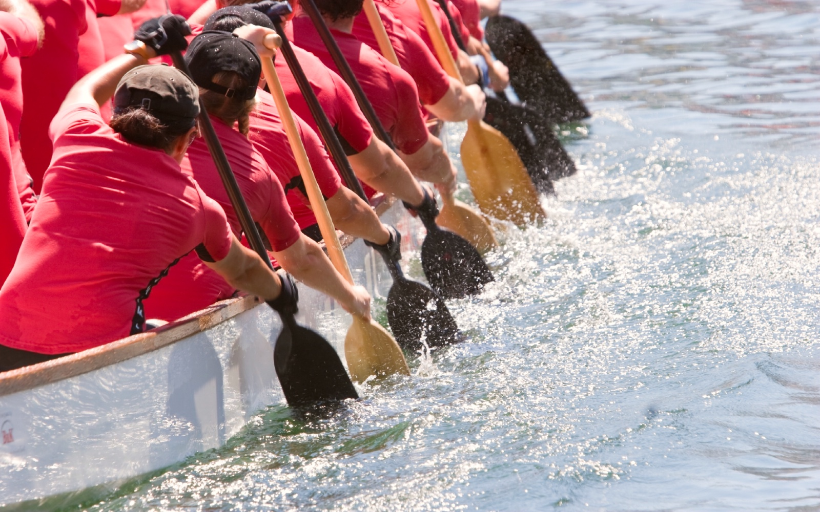 A group of paddlers compete in a dragon boat race