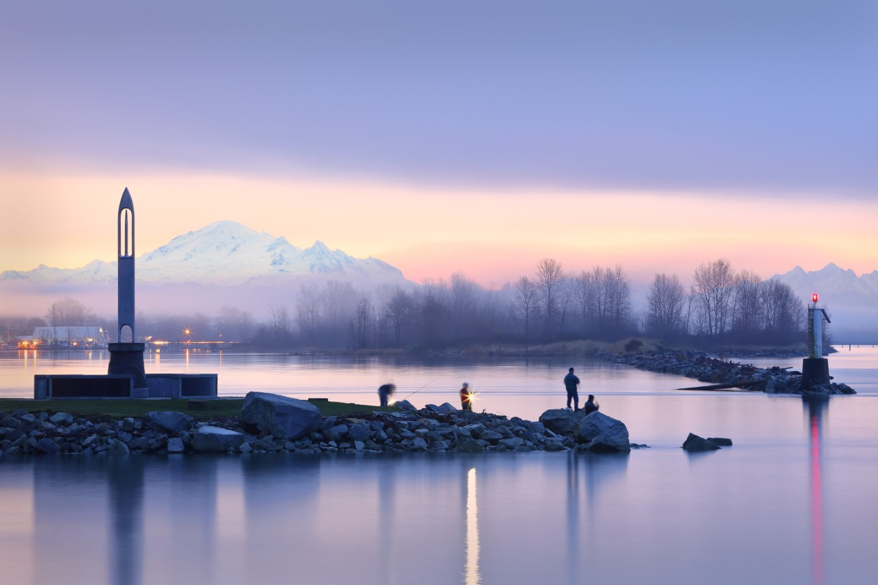 Fisherman cast at the entrance to Steveston Harbour