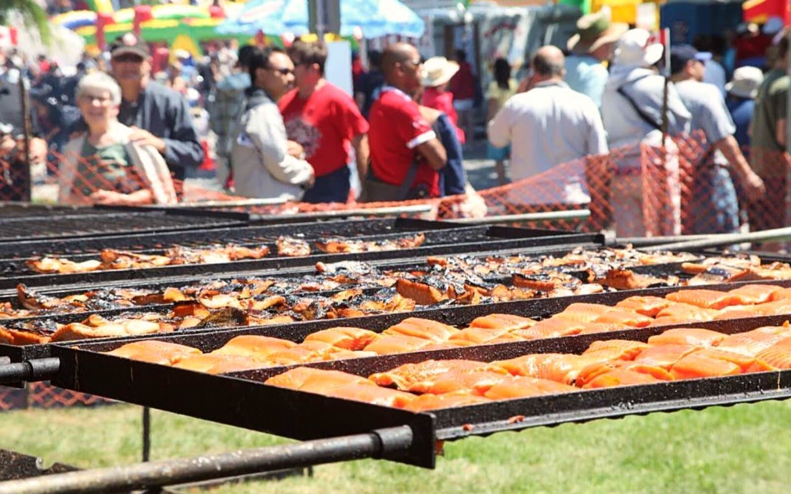 Dozens of pieces of sockeye sit on a grill at the Steveston Salmon Festival