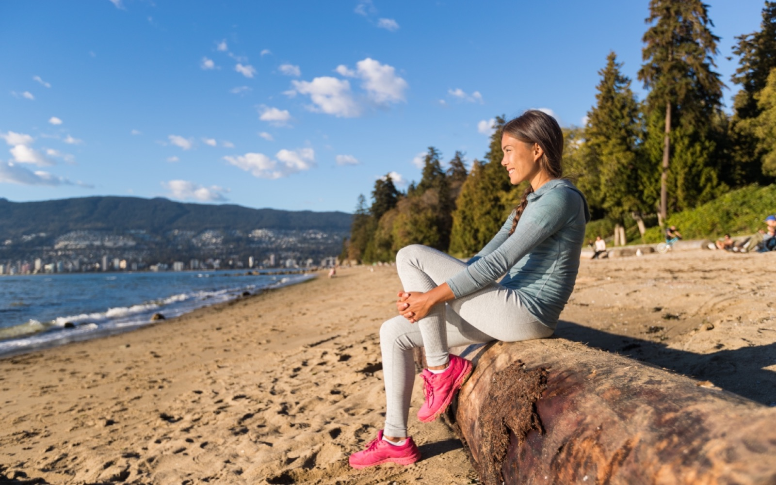 A woman relaxes at Third Beach, Vancouver