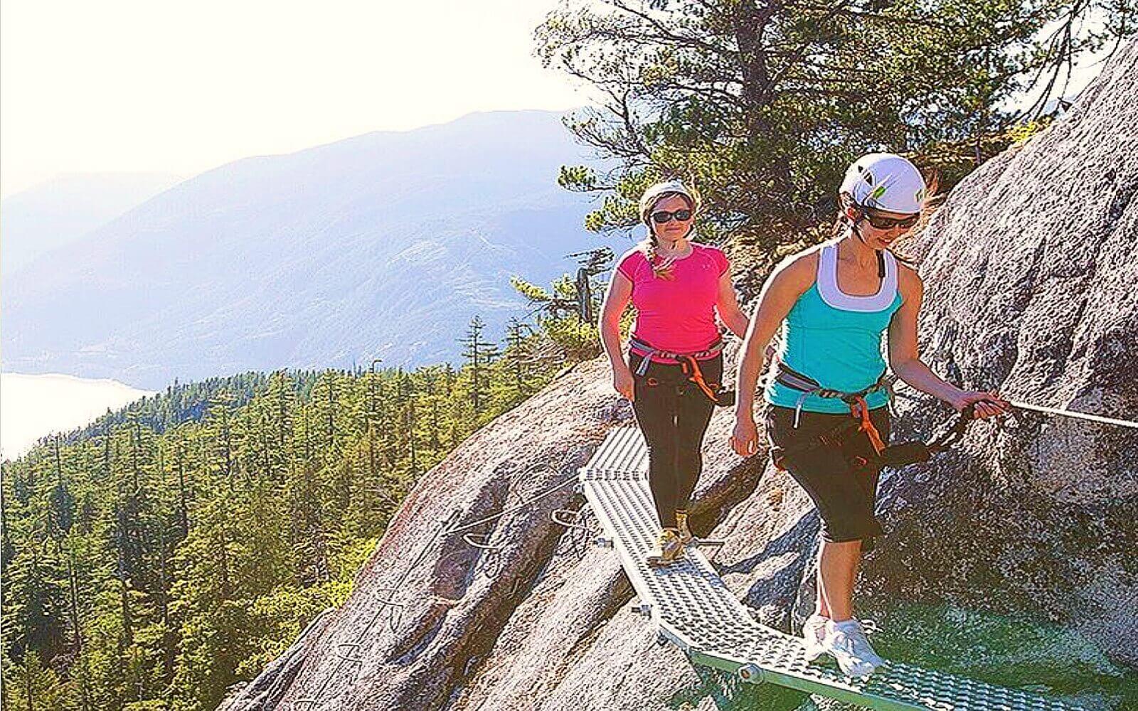 Two women enjoy the Via Ferrata Tour, Squamish BC