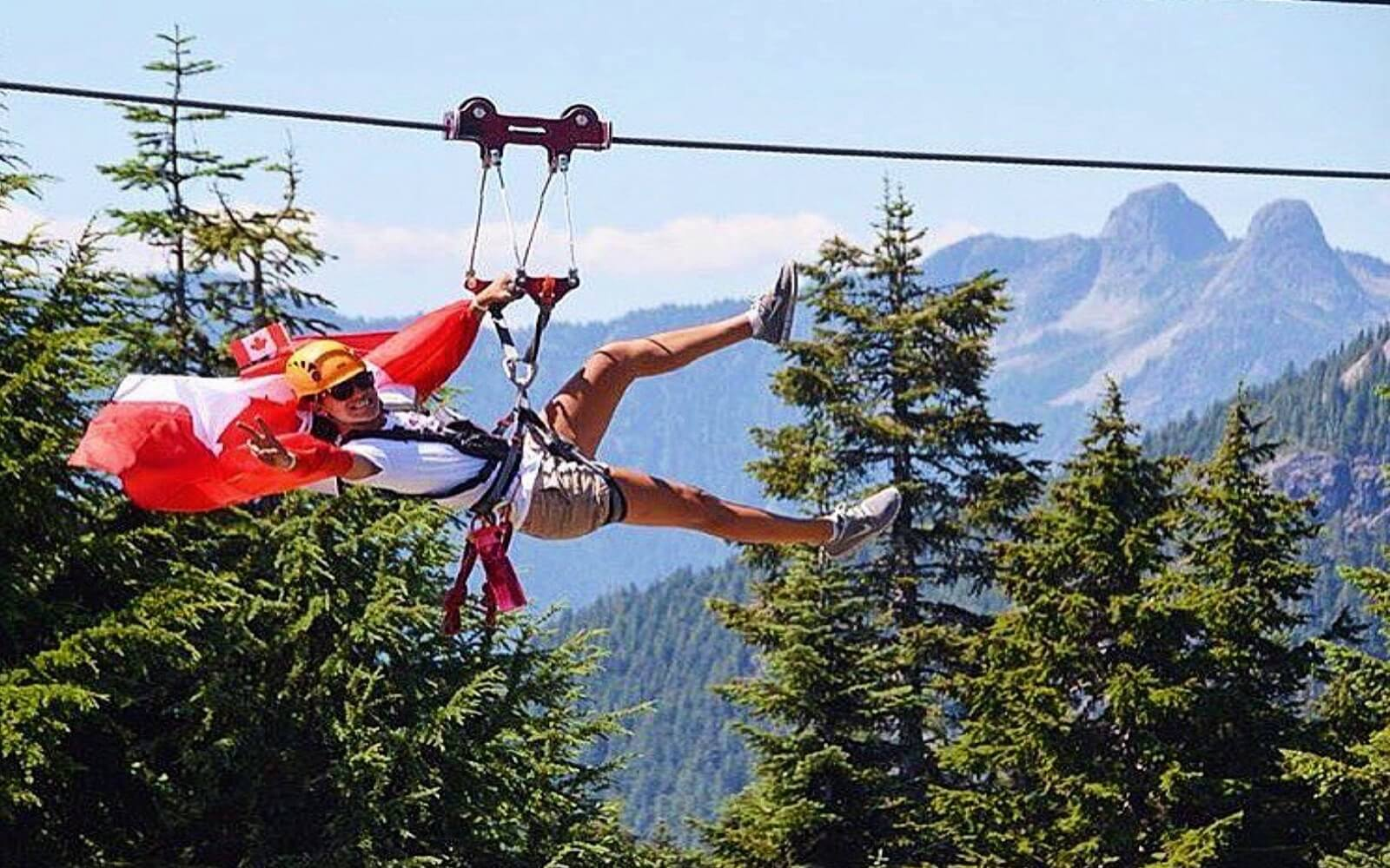 A woman ziplines at Grouse Mountain on Canada Day