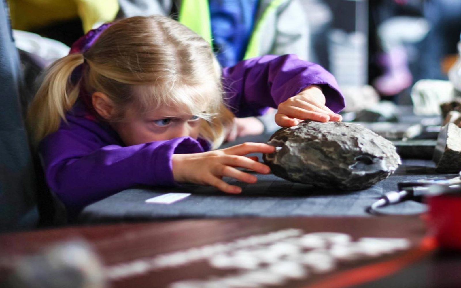 A girl inspects some minerals at the Mineral Gallery, Britannia Mine Museum