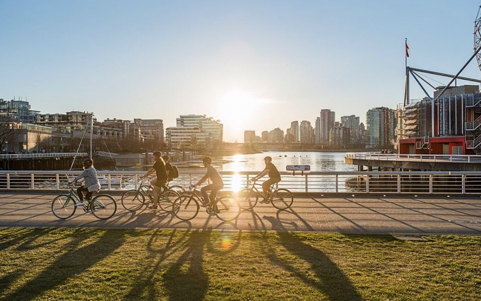 A cycle city tours passes Creekside park, vancouver