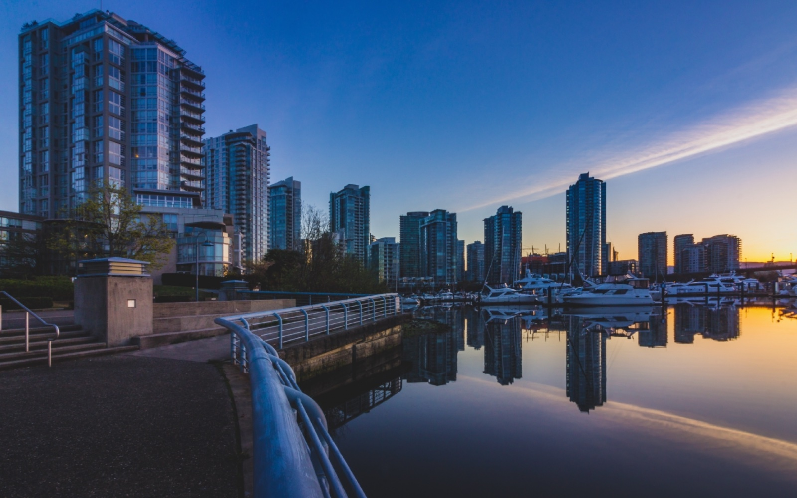 a view of the marina from the seawall in coal harbour vancouver bc
