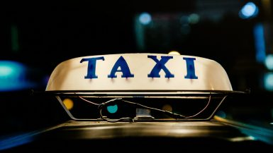 a taxi sign illuminated at night