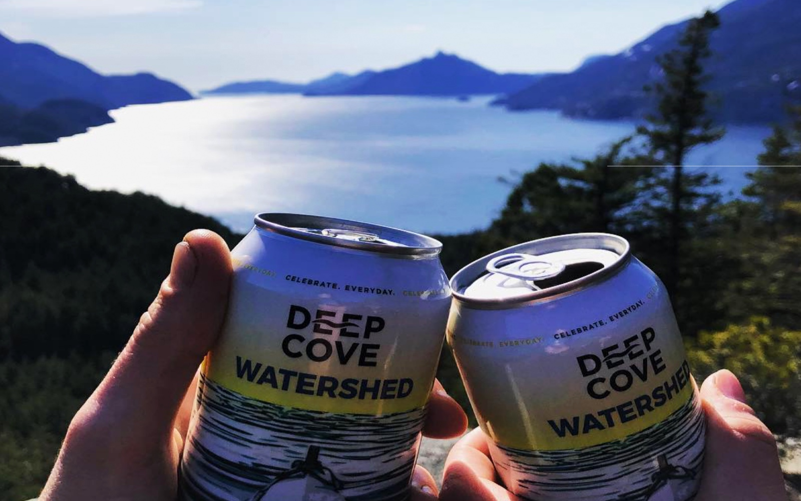 A couple drinks Deep Cove beers while hiking