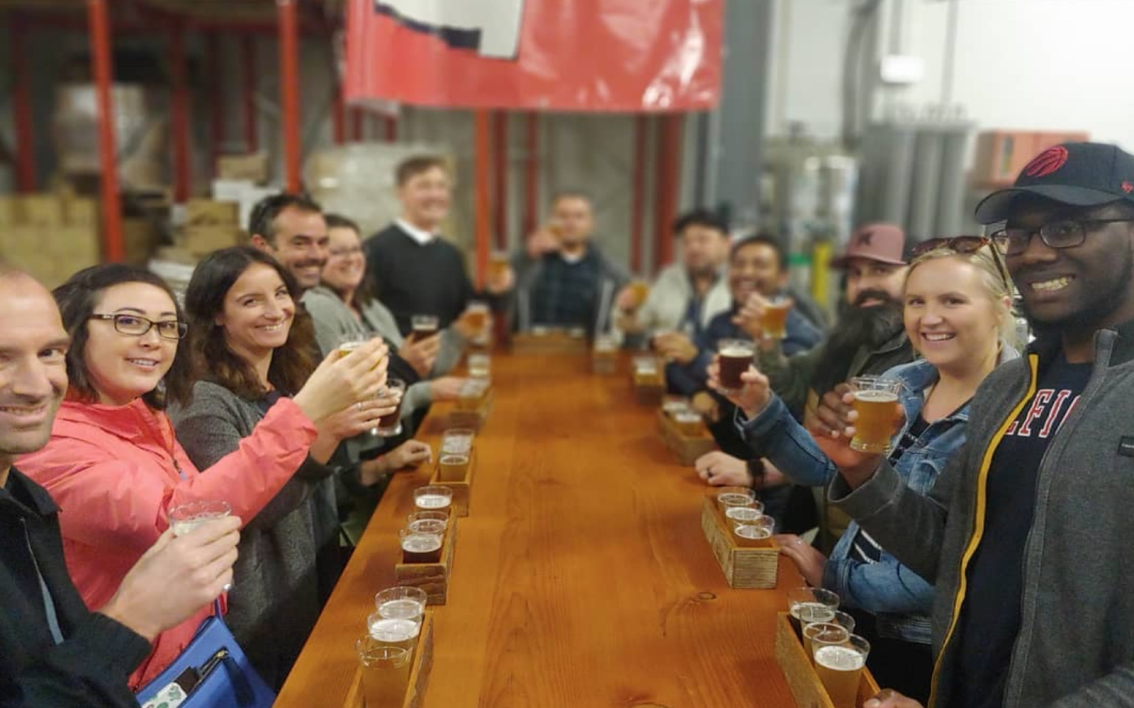 A group samples craft beers on a Vancouver Brewery Tour